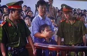 When the priest Nguyen Van Ly went on trial, he was cut short by a police officer, who put his hands over his mouth to stop him talking