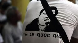 A man wearing a T-shirt displaying a portrait of democracy activist Le Quoc Quan is pictured during a mass in support of Quan at a catholic church in Vietnam on July 7, 2013 (AFP/FILE)