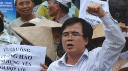This picture taken on July 8, 2012 shows lawyer Le Quoc Quan (C) shouting during an anti-China rally in Hanoi (AFP/FILE)