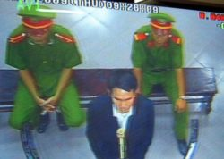 A closed-circuit television image shows Vietnamese democracy activist Pham Van Troi at his trial, Oct. 8, 2009.