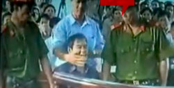 Father Nguyen Van Ly at Vietnam's Kangaroo Court on 30 March 2007. Photo from youtube.com