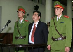 Cu Huy Ha Vu (C) in court in Hanoi during his trial, in a file photo.  AFP
