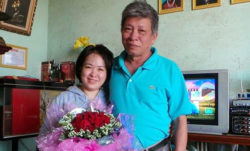 Do Thi Minh Hanh poses with her father after her release from prison, June 27, 2014. Photo courtesy of Do Thi Minh Hanh