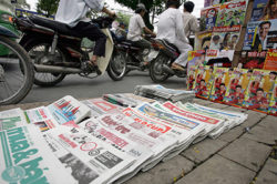 Newspapers are stacked on a Ho Chi Minh City street. The countrys state-run press is heavily censored, reporters say. (AFP/Hoang Dinh Nam)