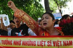 Activist Bui Thi Minh Hang (R) shouts anti-China slogans during a protest in downtown Hanoi, July 24, 2011.