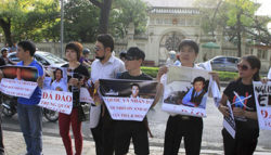 Anti-China protesters hold placards as they gather in front of the Chinese embassy in Hanoi