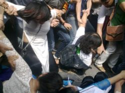 Hanoi plainclothes agents detain peaceful demonstrators, mostly women, on Sunday