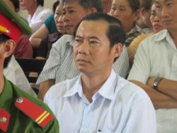 Nguyen Thai Hoc, head of department of Internal Affairs of Phu Yen Province, attends a trial in 2014, in which 5 police accused of killing a civilian