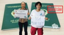 Ta Minh Tu (left) and Tran Thi Nga with banners to protest passport grant refusal of Vietnams police