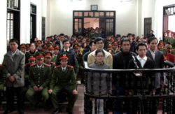 Activists convicted of plotting to overthrow the government listen to their verdicts at a court in Vinh, Nghe An province on Jan. 9, 2013.