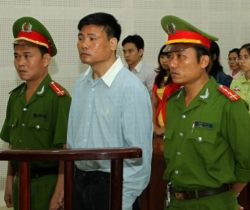 Truong Duy Nhat stands trial at a local Peoples Court in Danang, March 4, 2014.