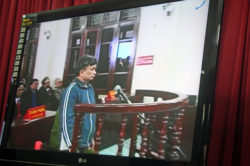 This screen shot from closed-circuit television shows the trial of Tran Anh Kim (C) in the northern Vietnamese city of Thai Binh, Dec. 28, 2009.