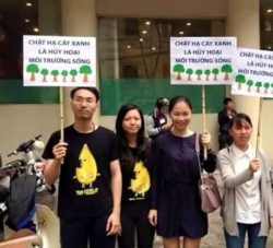 Activist Ly Quang Son (first left) in a green campaign to protest Hanois plan to chop down 6,700 aged trees in the citys center