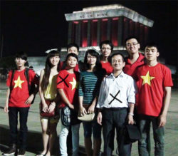 Tran Nhat Quang (white shirt) and other pro-government activists in Hanoi