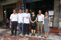 Poet Thach (second from right) and other activists visit former political prisoner Nguyen Xuan Nghia (third from left)