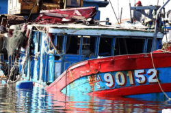 A Vietnamese fishing boat reportedly sunk by a Chinese ship sits in a shipyard in the central coastal city of Danang, June 2, 2014.