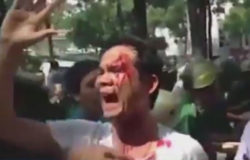 In a screenshot from a video, a protester shouts a slogan after a scuffle with police in Ho Chi Minh City, Nov. 5, 2015.