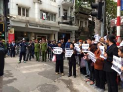Activists blocked by police and militia when they tried to attend the open trial against Mr. Dung on Dec 14