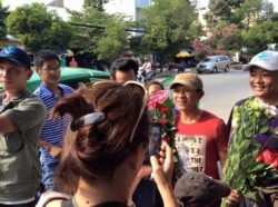 Music compositor Viet Khang (in red T-shirt) welcomed by activists