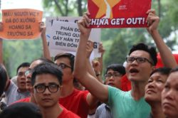Vietnamese protesters shout slogans in front of the Chinese embassy during a rally in Hanoi, May 11, 2014.