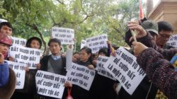 Mr. Tuan (center) at a protest to demand for returning land illegally seized by local authorities