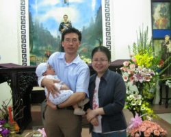 Mr. Ngo Duy Quyen and his wife Le Thi Cong Nhan and their baby in 2011