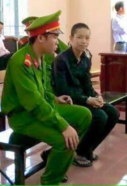 Handcuffed Nguyen Mai Trung Tuan in court room today [March 2]