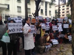 Hundreds of social activists and land petitioners gathered in front of the court building to demand for release of Nguyen Viet Dung