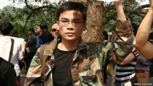 Mr. Dung at a peaceful demonstration on April 12, 2015 before being arrested by Hanoi police