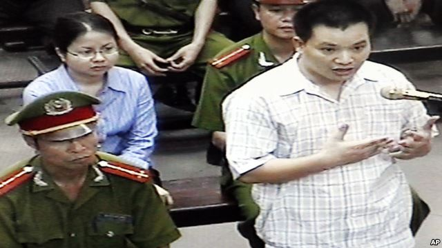 "FILE - Nguyen Van Dai, right, testifies in this May 2013 file photo, originally taken from TV footage. The well-known Vietnamese human rights lawyer was arrested on anti-state ""propaganda"" charges."