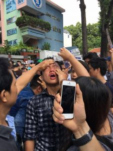 A protestor attacked with tear gas in Ho Chi Minh City on May 8, 2016
