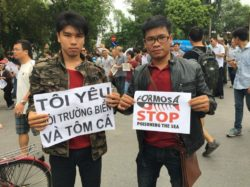 Former prisoner of conscience Pham Minh Vu (left) at a peaceful demonstration on environmental issue in Hanoi in May 2016