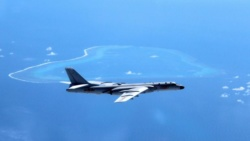 South China Sea: Australia in three-way rebuke of China