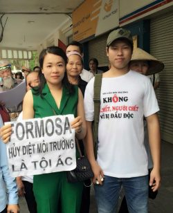 Mr. Phuong (right) at a peaceful demonstration in Hanoi in May against Formosas pollution