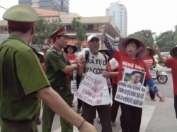 Mrs. Can Thi Theu at a peaceful demonstration in Hanoi